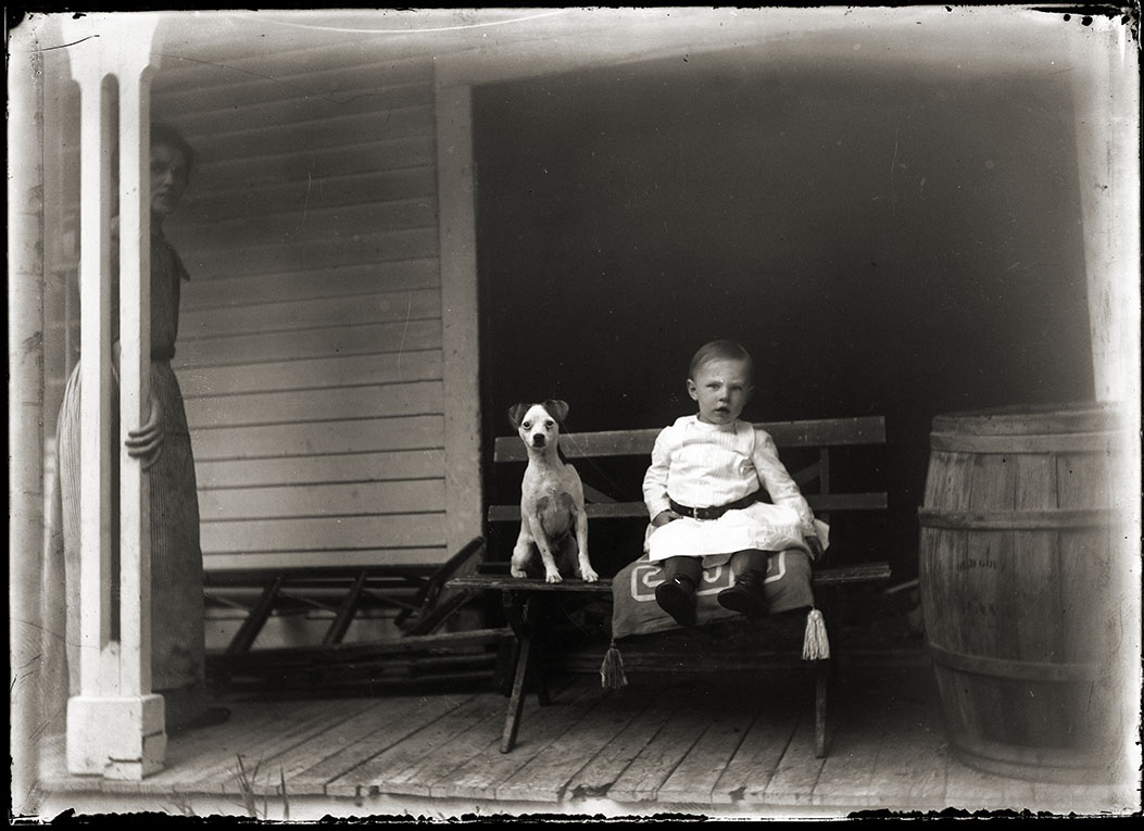 Child and dog, by Burt Brooks, ca.1910