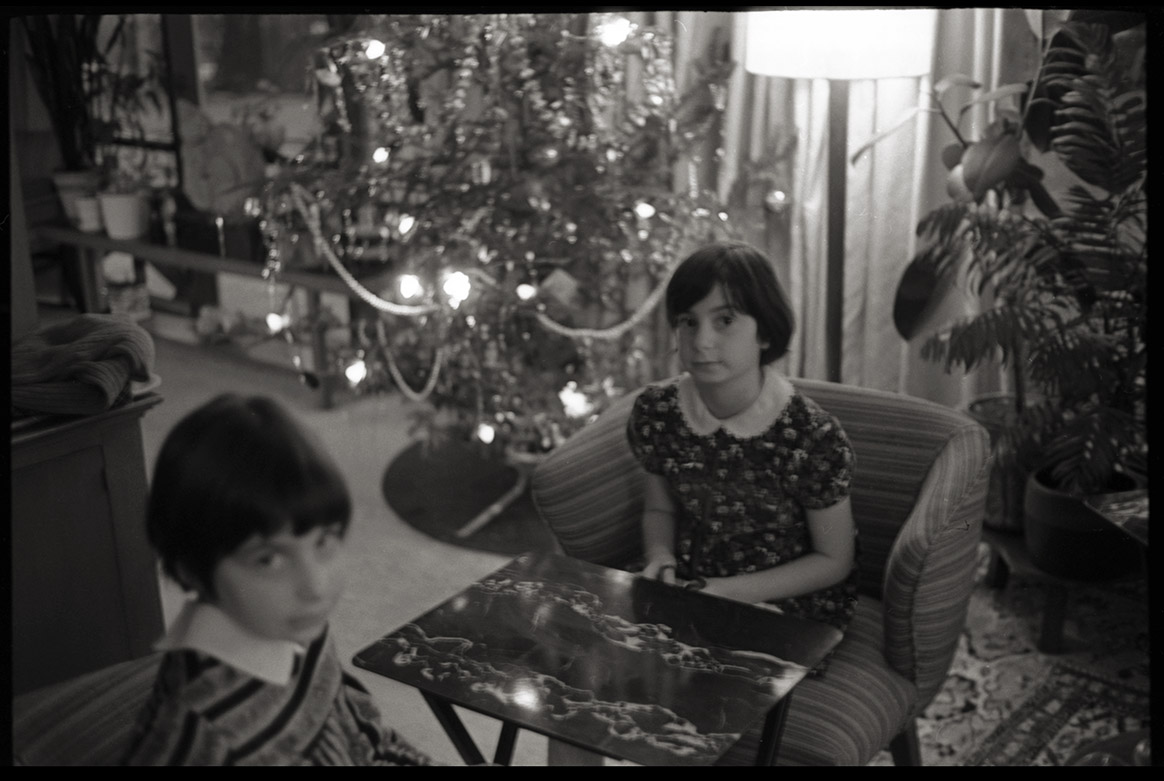 Photo of twins at Christmas time, by Tom Benedek