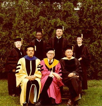 Group, including President Wood, Randolph Bromery and Honorary Degree recipients, posing outdoors, Commencement 1977