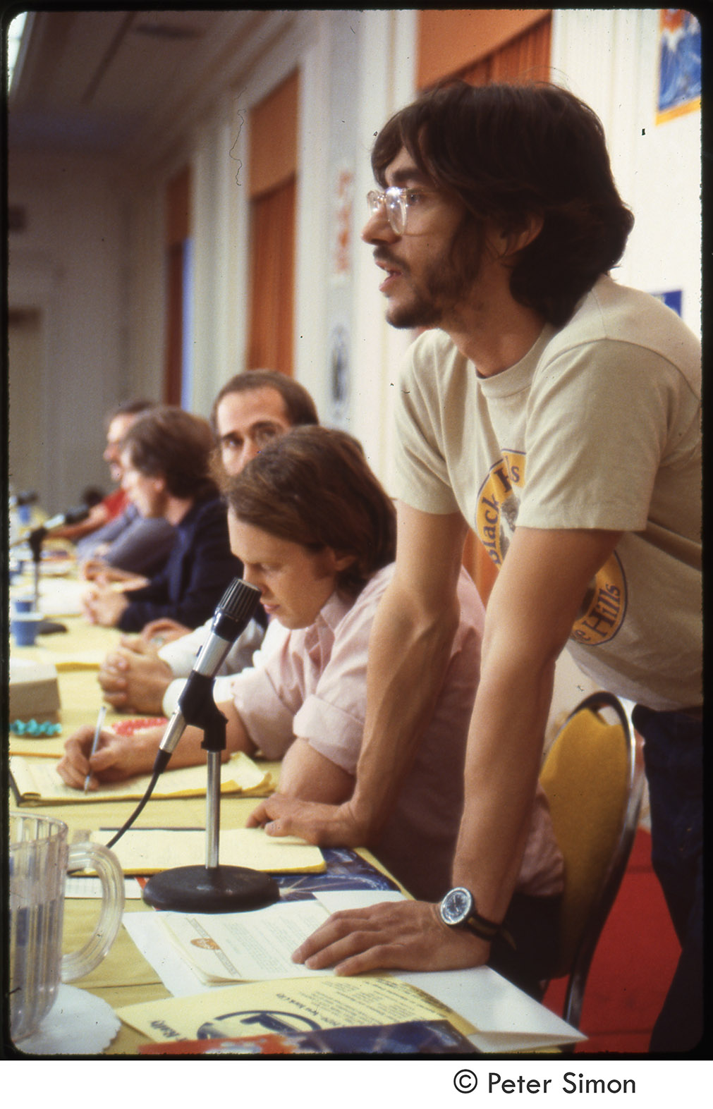 Depiction of Harvey Wasserman at MUSE press conference, 1979