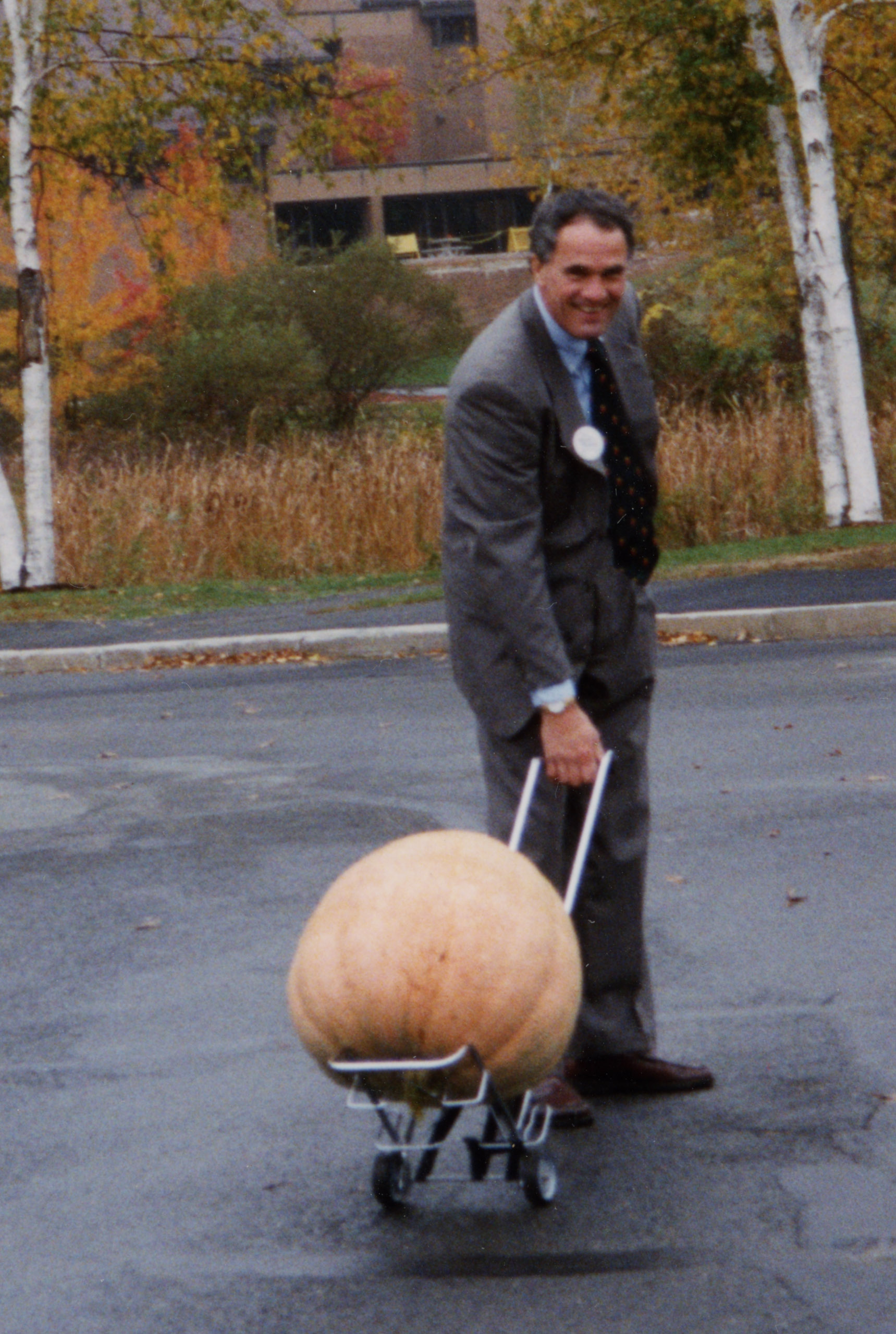 Depiction of Jay Healy with a pumpkin, Greenfield, Mass., 1998