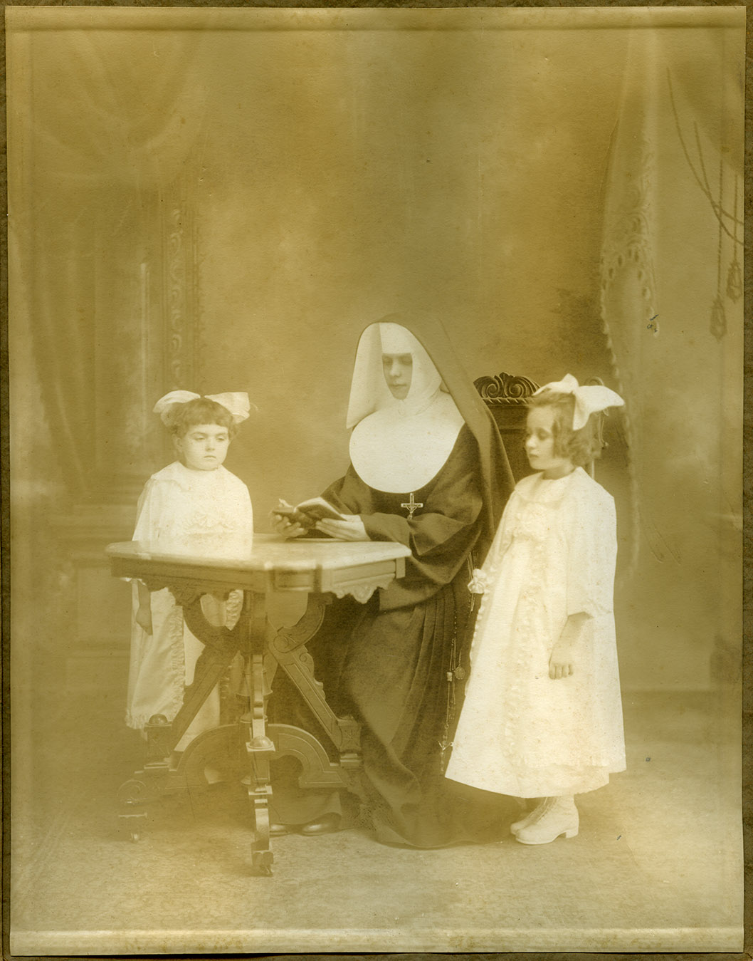 Depiction of Nun and two girls at first communion, ca.1920