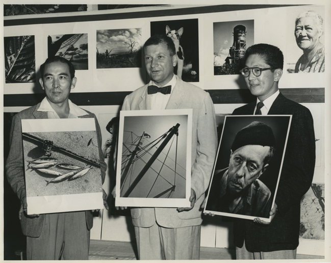 William Lederer with others receiving award for photograph.