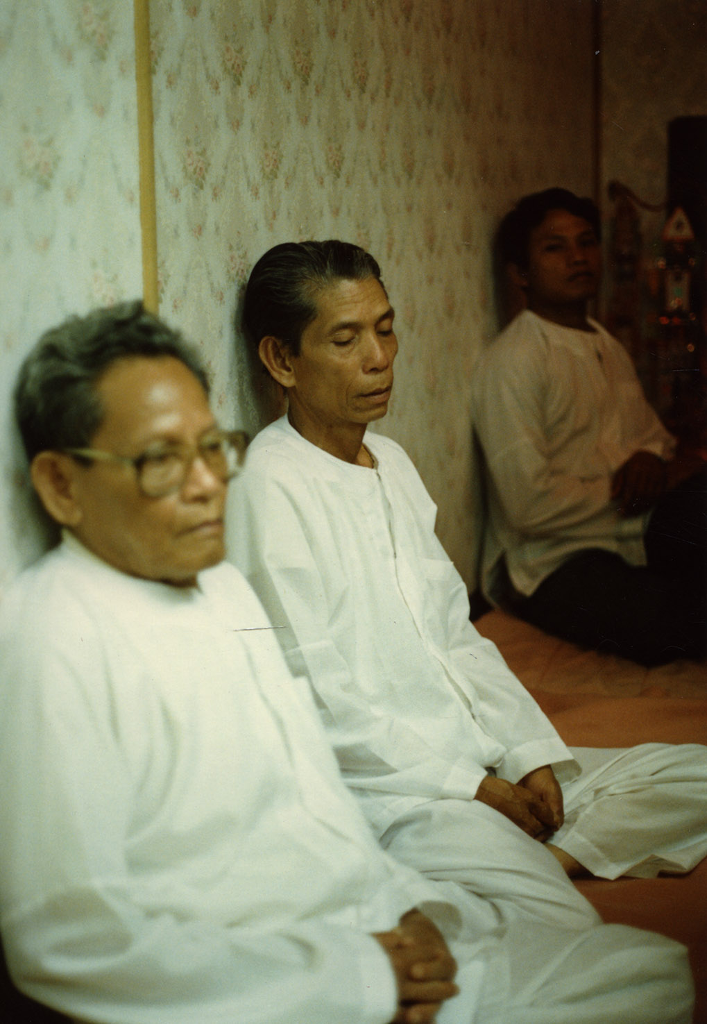 Image of Men at consecration of statue at the Trairatanaram Temple, 1987
