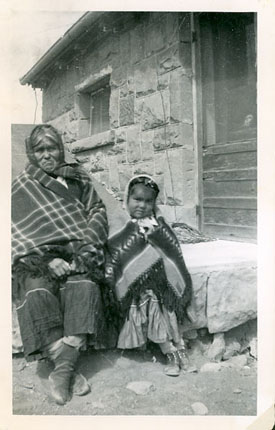 An image of: Widow of local leader in Oraibi and her granddaughteron the clinic steps, May 1952