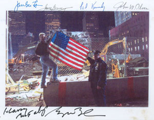 Kelley raising the flag, Ground Zero, 2001