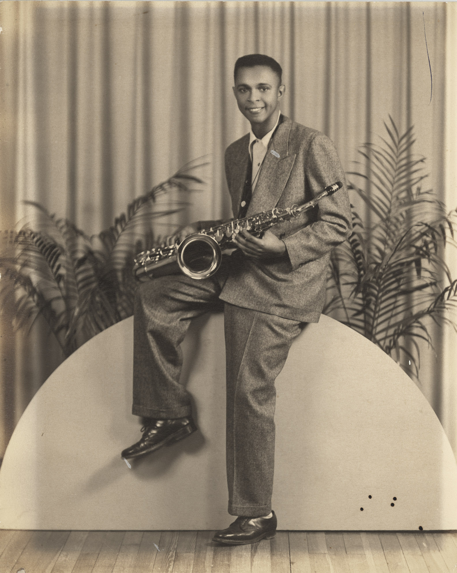Depiction of Tiyo Atallah Salah-El playing saxophone in high school