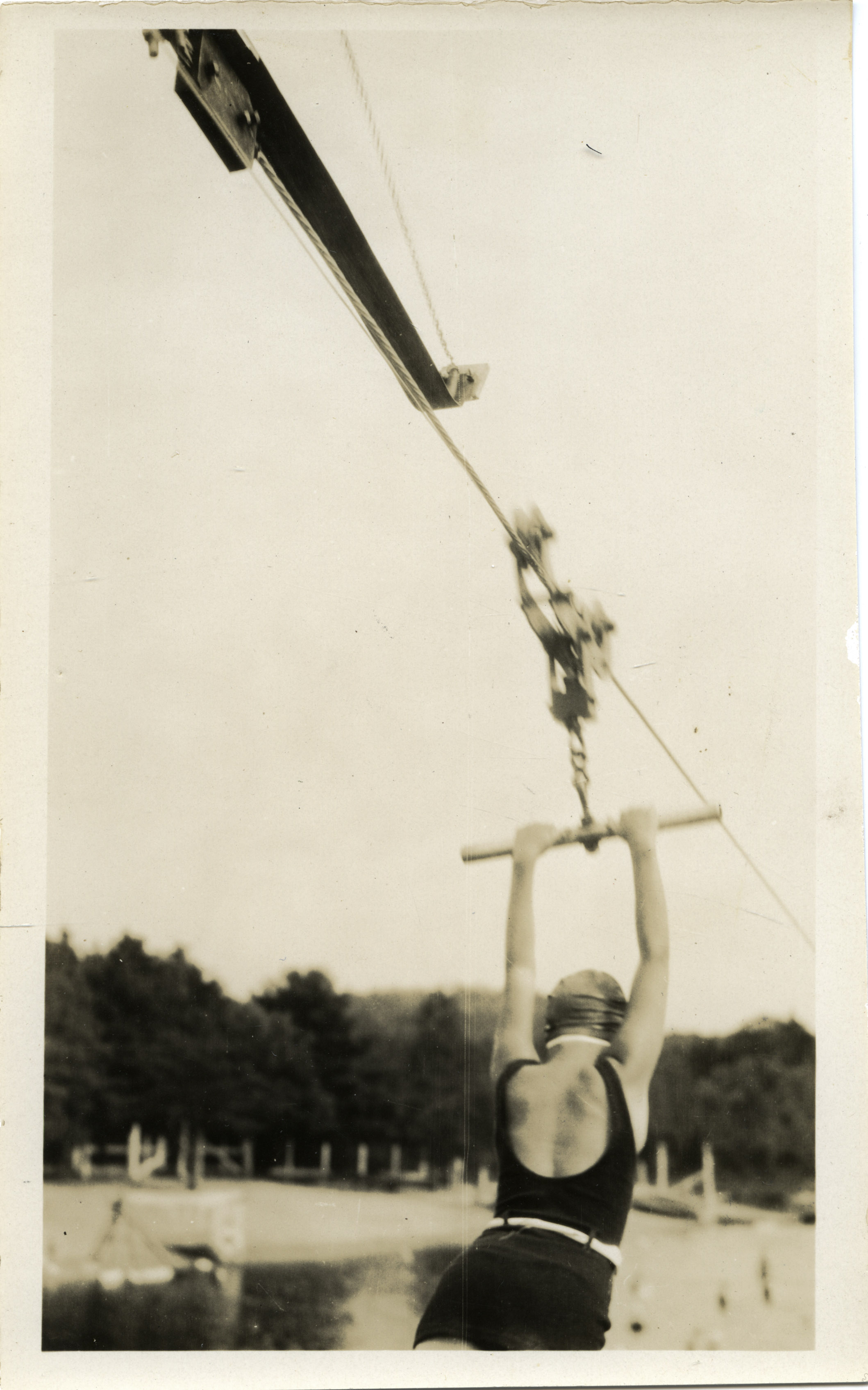 Depiction of Woman on a zip line at Lake Rohunta, ca.1925