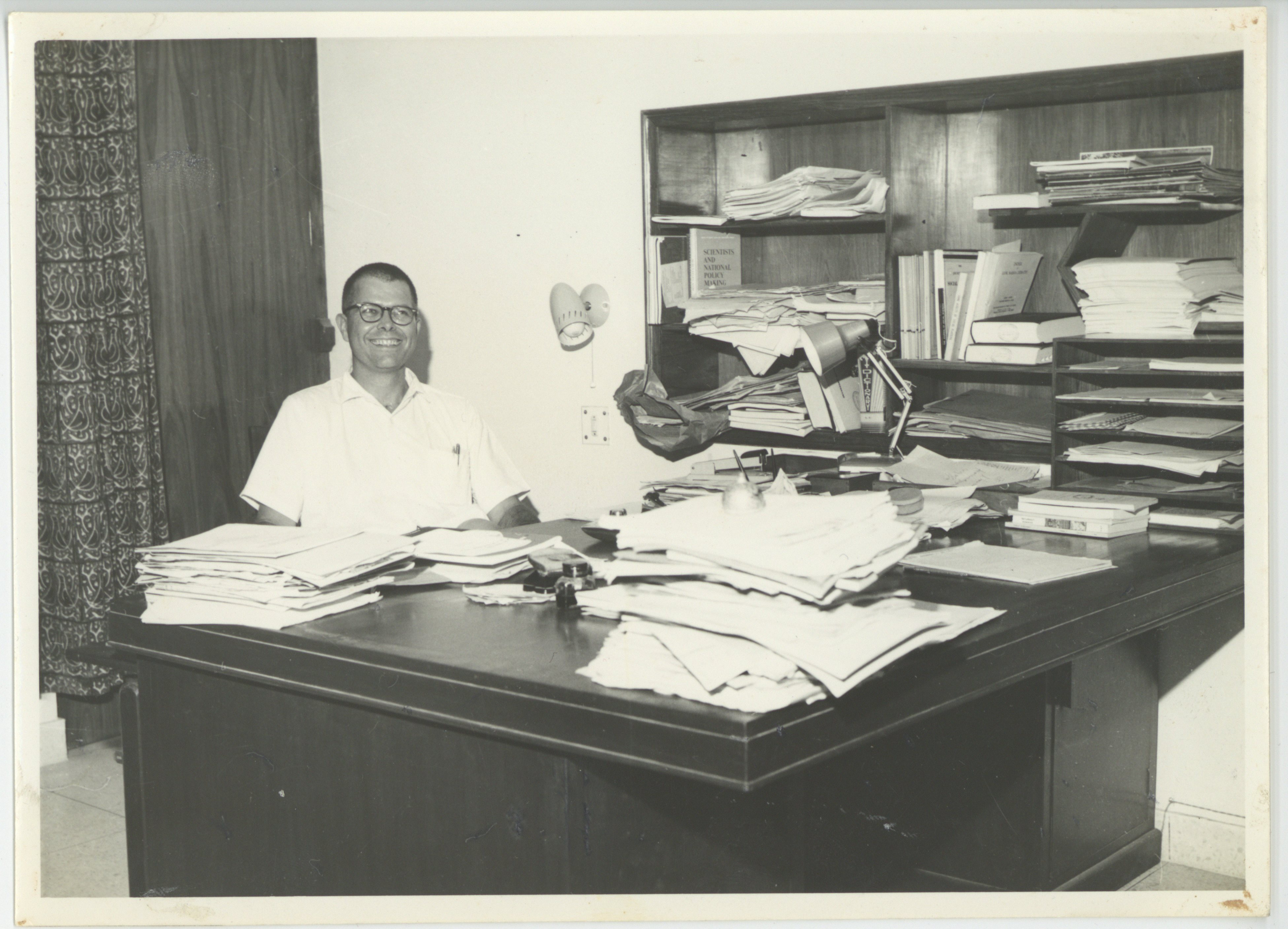 Image of Ward Morehouse at his desk in the Educational Resources Center, New Delhi, 1966