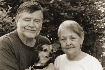 Depiction of Bob and Martha Perske with their dog, Wolfie, 2004