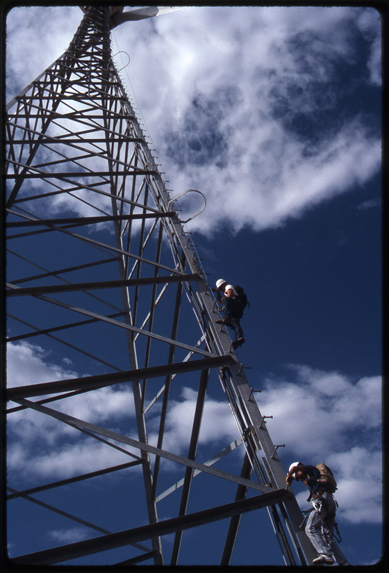 Engineers climbing a turbine, Tehachapi, Calif., Aug. 1992