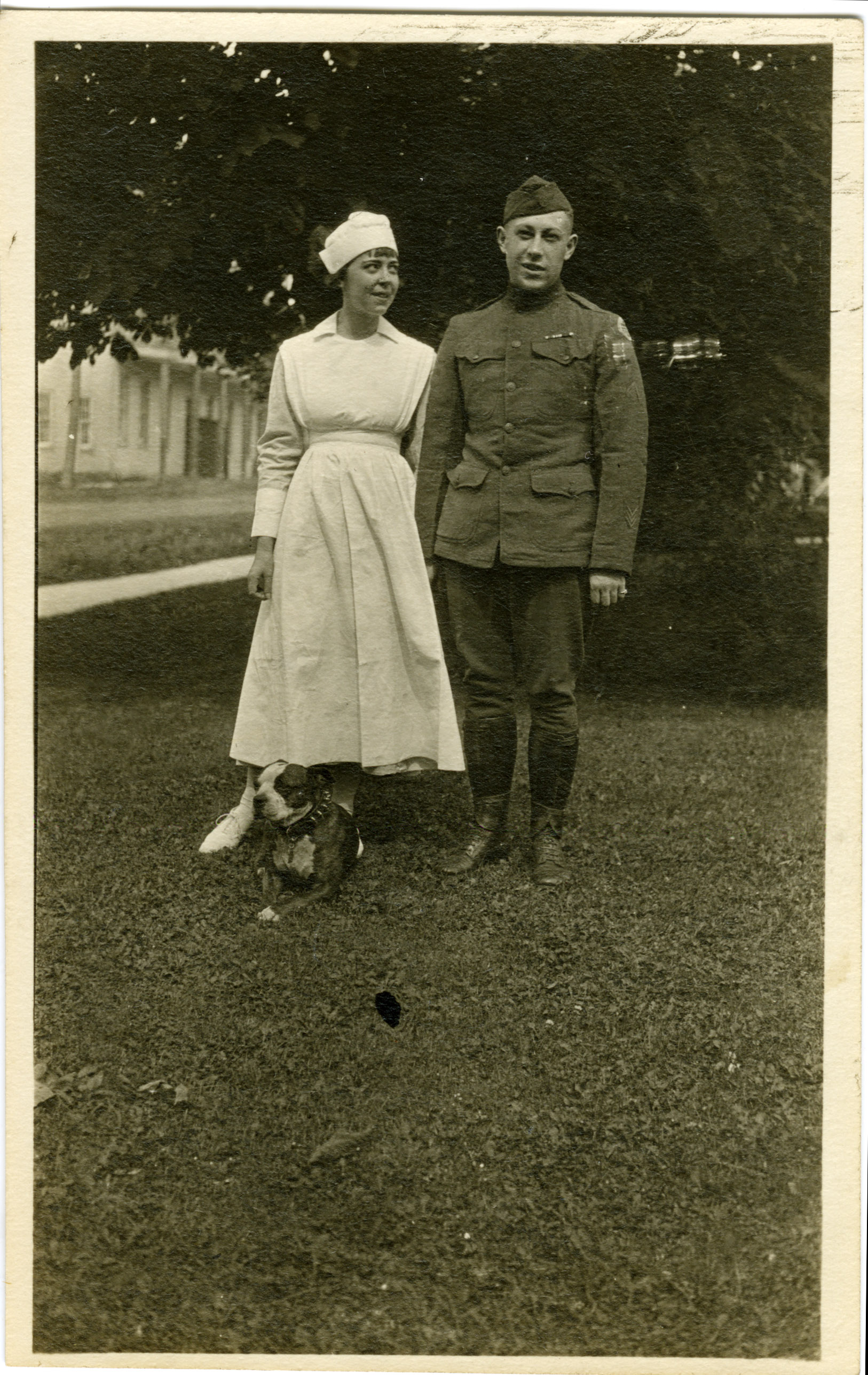 Image of Lawrence D. Yeomans, nurse, and dog