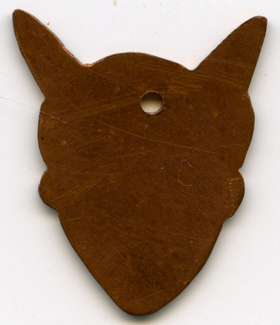 Brass mouse-head template used in genetic work at Mount Hope