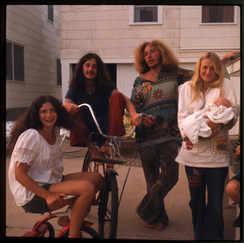 Image of Nina, Smoky, Chuck, Janis (Smoky and Nina on bikes)