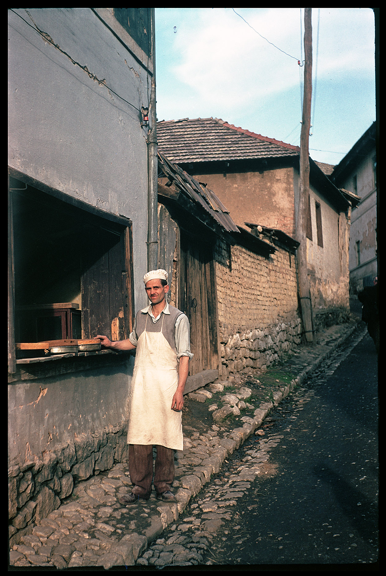 Depiction of Bosnian baker at his shop, ca.1955