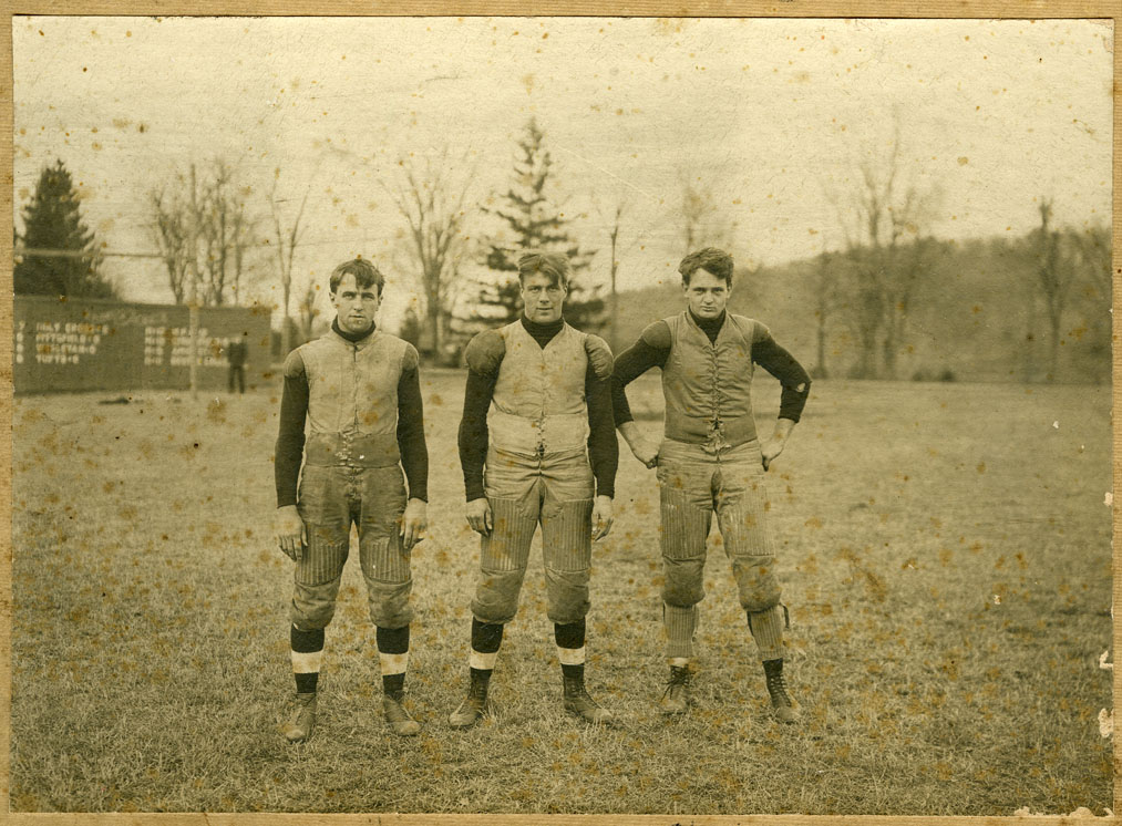Depiction of Chet Whitaker, Bill Munson, Chick Lewis (football players)